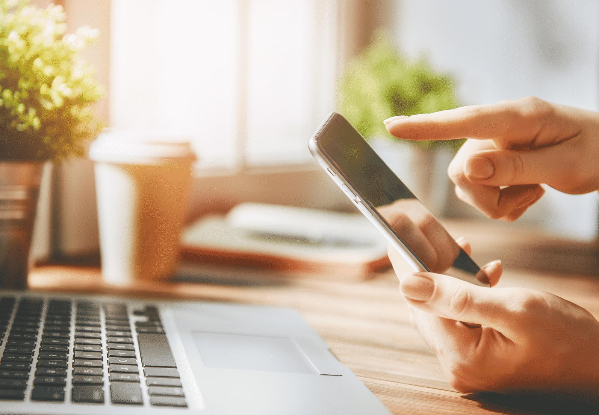 checking stocks on smartphone